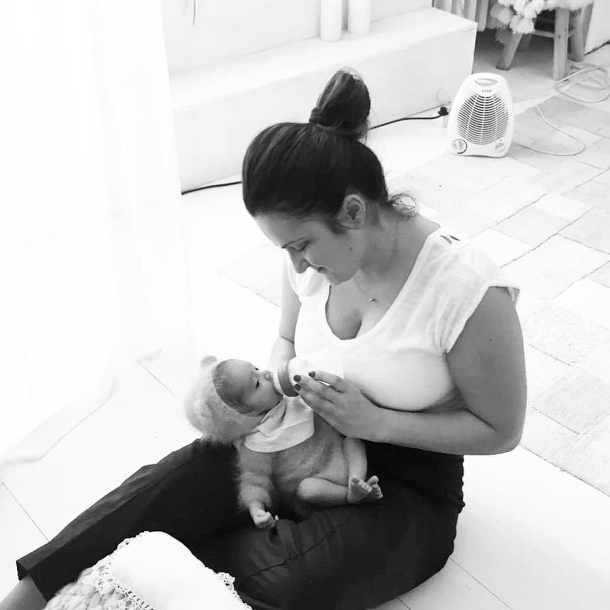 Nicoleta Raftu maternity and new born photographer for workshops by Carmen Bergmann Studio feeding the new born in preparation for shooting