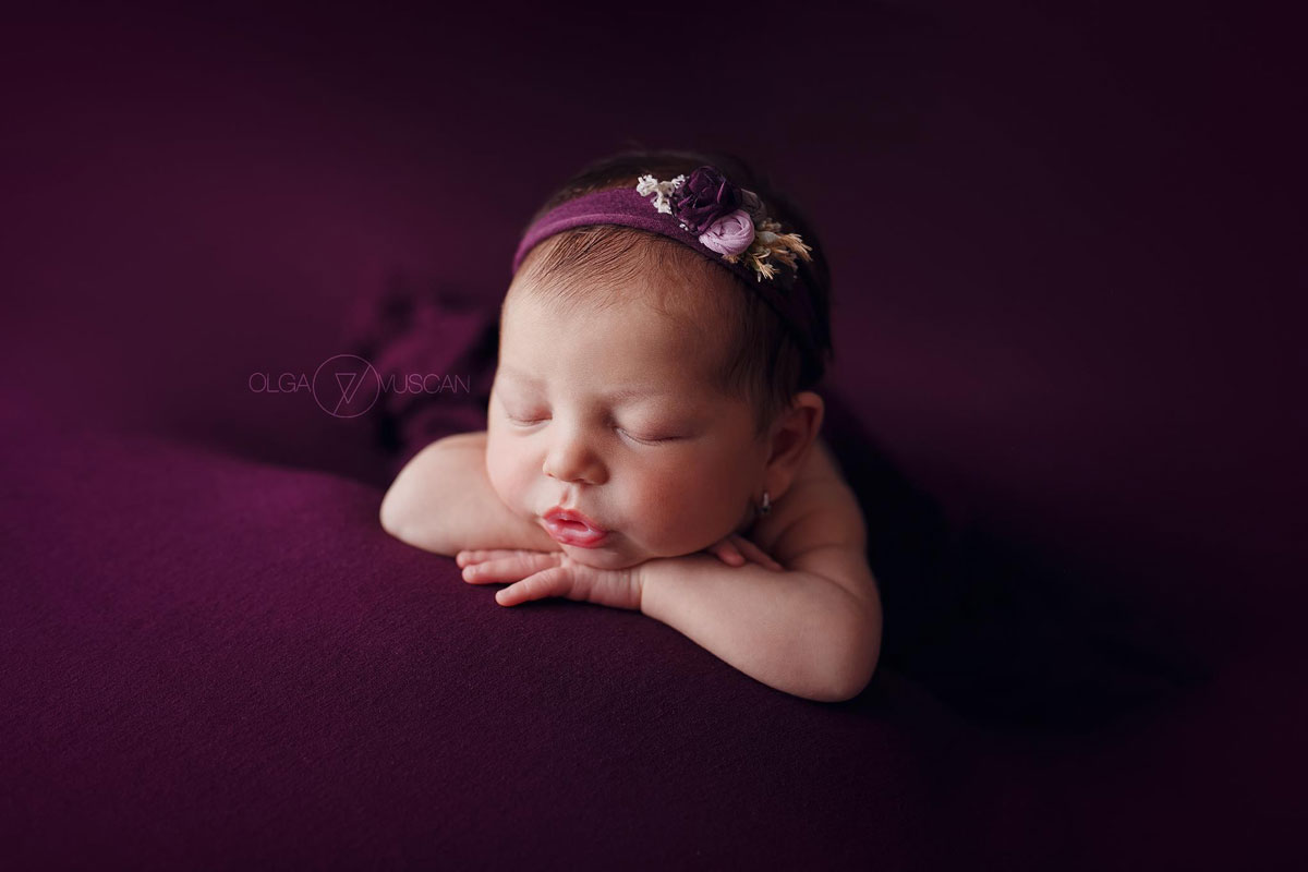 Olga Vuscan New Born Photographer for Workshops by Camen Bergmann Studio new born girl sleeps on violet cover